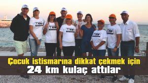 Çocuk istismarına dikkat çekmek için 24 km kulaç attılar
